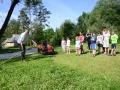 Mowing grass.